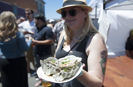 Shelling out the good stuff at the 26th annual Arcata Bay Oyster Festival. - MARK MCKENNA