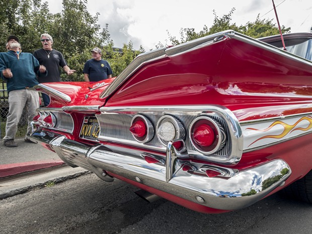 Allen Mann, of Fieldbrook (second from left), entered his 1960 Chevrolet Impala in the 12th annual Bill Nessler Car Show that followed the Annie & Mary Day parade in Blue Lake on Sunday. - MARK LARSON