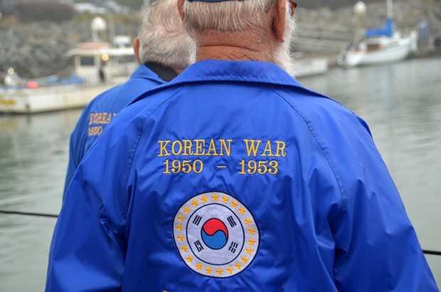 "Korean War veteran Warren Longnickel, 83, of Carlotta and fellow veteran Don Biasca head down the dock to board the U.S. Coast Guard cutter Dorado for the commemorative wreath ceremony. U.S. involvement in the ""Korean conflict"" ended in 1953. - TED PEASE"