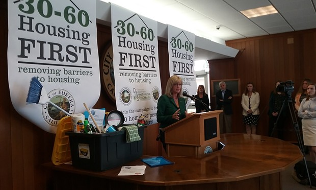 """Supervisor Virginia Bass speaks at the launch of the city and county's Housing First campaign. The cleaning supplies were donated by a local outreach group as a """"welcome home"""" gift to new renters. - LINDA STANSBERRY"""