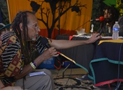 Sakura Koné, a.k.a. the Roots Master, poses a question at the press conference. - ERICA BOTKIN