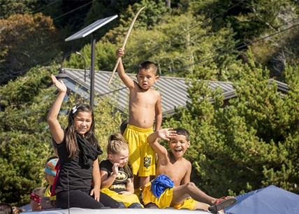 The Klamath Stick game team represents from a truck in the parade. - MARK LARSON