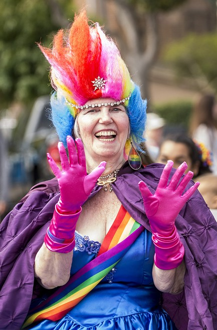 Parade marshal Linda Shapeero brought the color with her Pride ensemble and signature rainbow earrings. - MARK LARSON