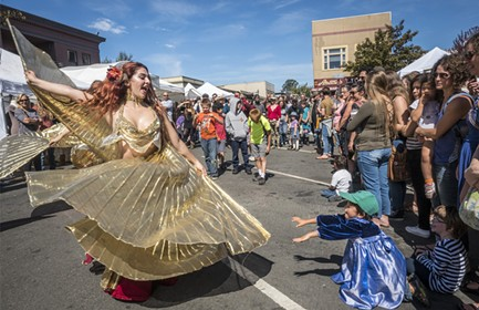 Belly dancers performed in the Samba Parade and the Ya Habibi Dance Company danced later on the plaza lawn at the North Country Fair on Saturday. - MARK LARSON