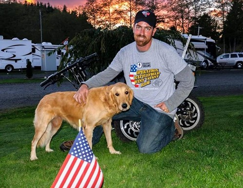 Cook and his loyal service dog, Ivy. - FACEBOOK