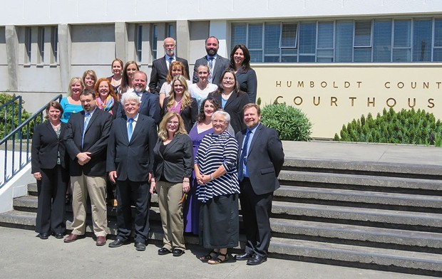 Kevin Robinson, center front, with the rest of the Public Defender staff. - FILE