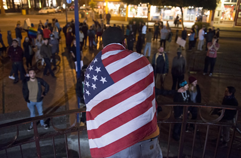 A pro-Trump counter protester at the Old Town gazebo on Thursday evening. - MARK MCKENNA