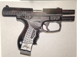 A police photograph of the replica handgun reportedly found on McClain. - FILE