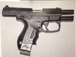A police photograph of the replica handgun reportedly found on McClain. - THADEUS GREENSON