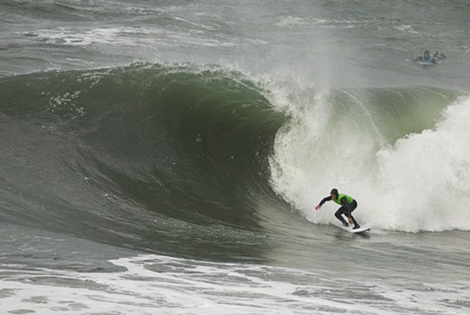 Organizer Chris Johnson catching a wave. - SEAN JANSEN
