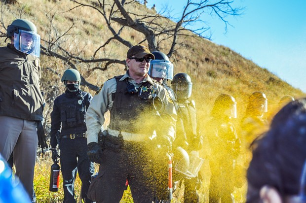 Protesters are pepper sprayed while occupying the proposed route of the Dakota Access Pipeline. - ROB WILSON