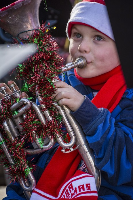 Jude Carter, 6, of Eureka, played in his fourth TubaChristmas performance, along with his father and grandmother, in front of a crowd of 100 or more at the Gazebo in Old Town Eureka on Saturday, Dec. 3 - MARK LARSON