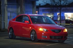 The red Mazda allegedly stolen from Sole Savers and abandoned about a block away. - MARK MCKENNA