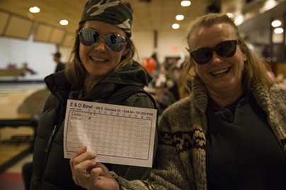 Karen Smith and her daughter holding up their score card from the the LeBOWLski event at the E&O bowling alley. - SAM ARMANINO