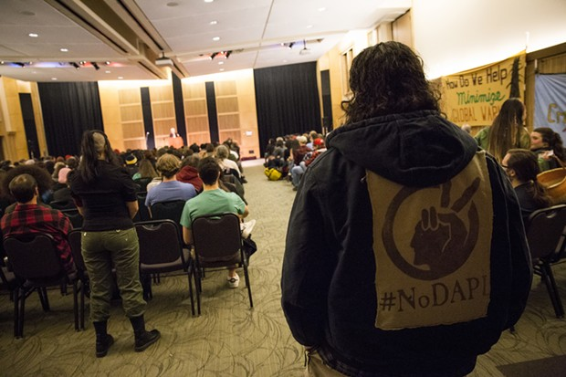 """Erik Rydberg wearing a jacket that reads """"#NoDAPL"""" at the Jill Stein discussion held at Humboldt State University on March 8. - SAM ARMANINO"""
