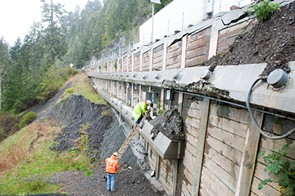 Workers gather data from load sensors on a retaining wall that is at one of the fail points. - PHOTO BY MARK MCKENNA
