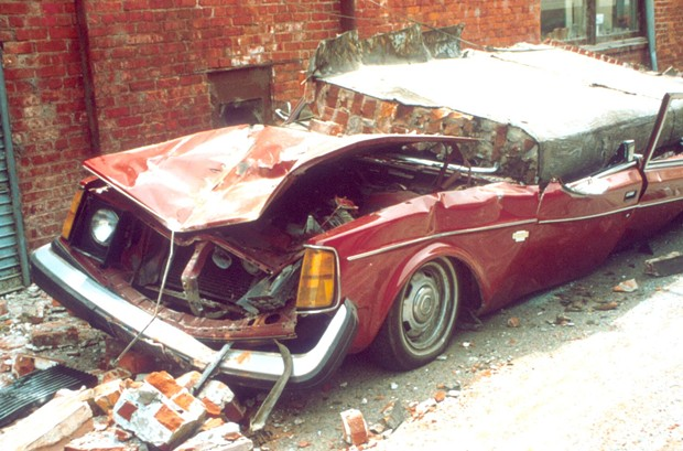 A brick wall crushes a car in Ferndale. - COURTESY OF REDWOOD COAST TSUNAMI WORKING GROUP