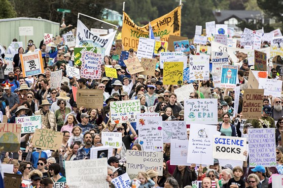 The March for Science made its way through Arcata with a rising sea of signs. - PHOTO BY MARK LARSON