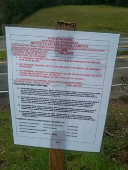 A notice posted near a homeless camp on U.S. Highway 101 near Garberville telling people to be out by Feb. 27, the date of the Point in Time Count. - DEBRA CAREY