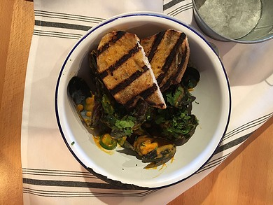 Mussels with a splash of Thai curry. - JENNIFER FUMIKO CAHILL