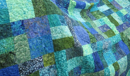 """""""Splash,"""" the queen-sized Opportunity Quilt to be raffled off at the Heart of the Redwoods Quilt Show. - PHOTO BY CAROL HARRISON"""