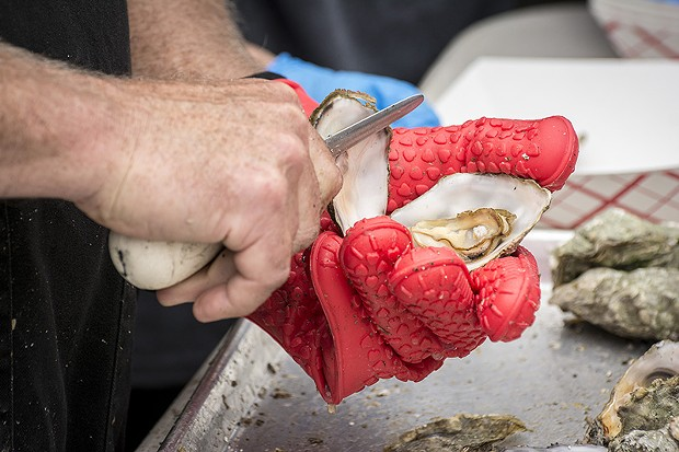Tens of thousands of locally produced oysters met their fate at the 27th annual Oyster Festival. - PHOTO BY MARK LARSON