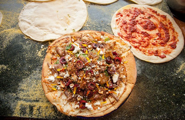 Duck confit salad pizza with chèvre. - AMY KUMLER