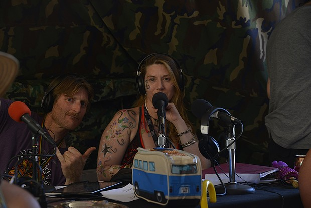 "DJ Paradigm and Ona of KMUD Redwoods Community Radio in the press tent, Sunday afternoon. DJ Paradigm hosts the Rankin' Reggae Rotation on Saturday nights. Ona hosts the show ""63 Miles to Sunrise"" on Tuesday mornings. - PHOTO BY ERICA BOTKIN"