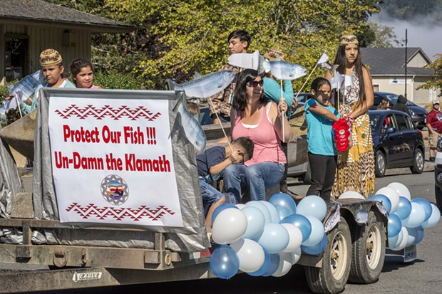 Participants representing the Yurok Tribe Social Services Department advocated for salmon and dam removal and tossed candy to the crowd from their parade float at the 2016 Klamath Salmon Festival. - MARK LARSON
