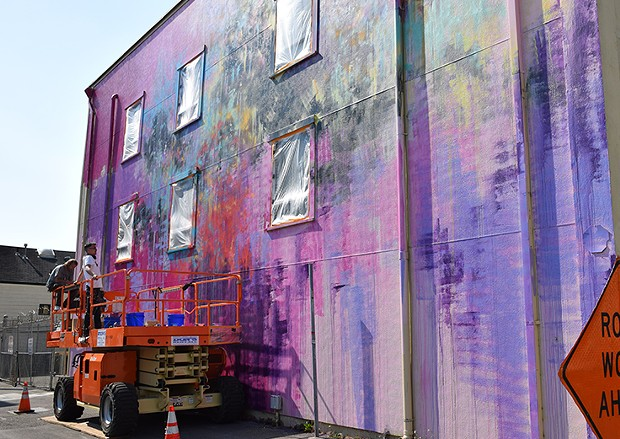 Muralist Duncan Jago and Joe Murdter work on the De Paul Building. - JENNIFER FUMIKO CAHILL