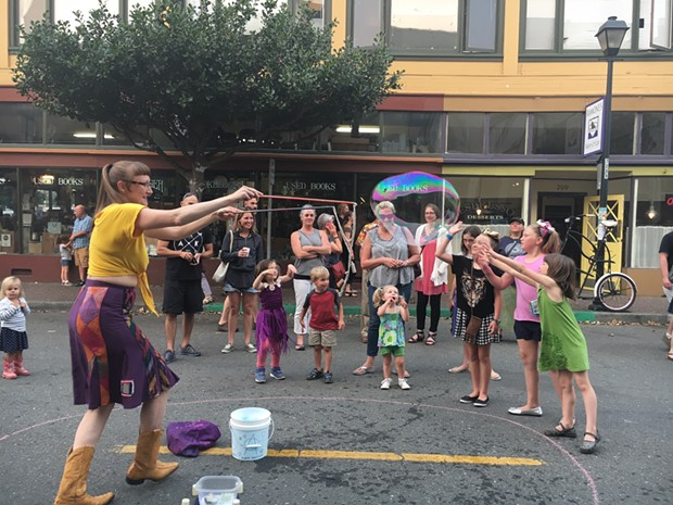 Kids of all ages lent color to the Opera Alley Block Party on Saturday during Arts Alive. - JENNIFER FUMIKO CAHILL