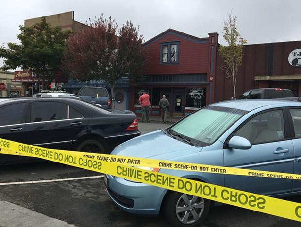 The taped-off crime scene at bar row on the Arcata Plaza. - THADEUS GREENSON