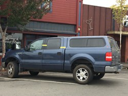 This truck, marked with evidence tape and awaiting towing, is reportedly the vehicle from which the suspect emerged and opened fire this morning. - THADEUS GREENSON