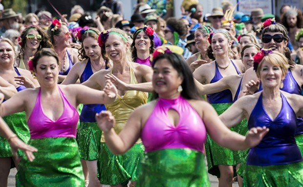 Samba da Alegria drew a crowd for the parade on the second day of the North Country Fair. - PHOTO BY MARK LARSON