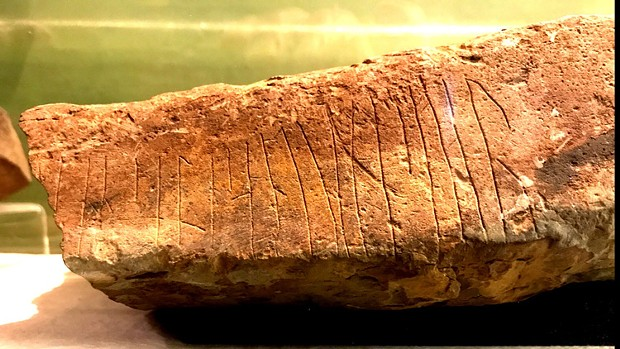 """""""... Are in heaven, hallowed be ..."""" reads this runic fragment from the Lord's Prayer, on a stone found near Ophir, Orkney. It's now in the Kirkwall Museum. - PHOTO BY BARRY EVANS"""