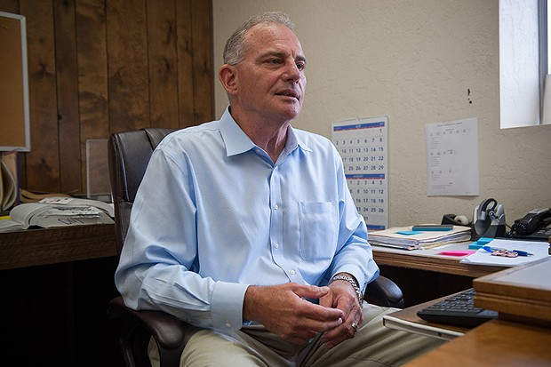 Humboldt County Public Defender David Marcus in his sparsely decorated Eureka office. - PHOTO BY MARK MCKENNA