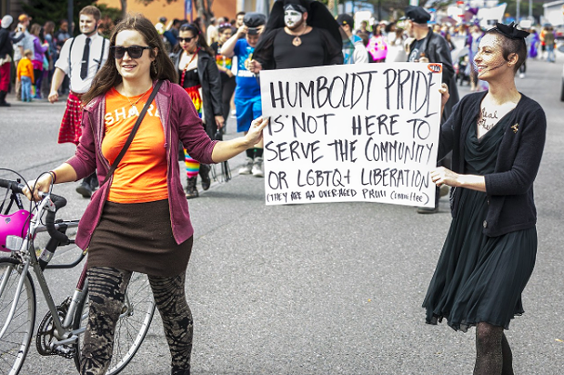 Protesters carried signs in the 2016 Humboldt Pride march. - PHOTO BY MARK LARSON