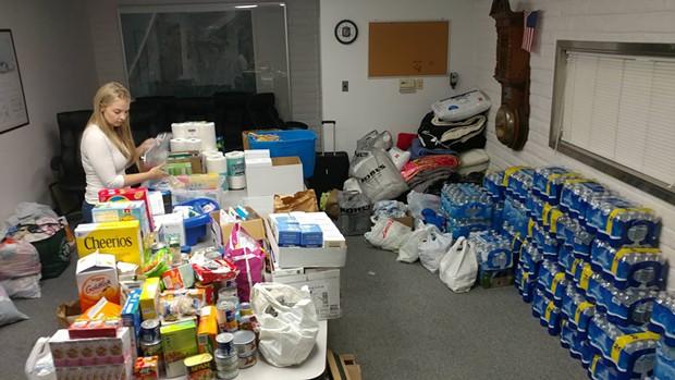 Jenna Harris sorting donations at Humboldt Bay FIre - AUSTIN ALLISON