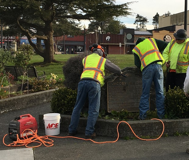 City workers loosen the 1963 marker. - COURTESY OF THE CITY OF ARCATA
