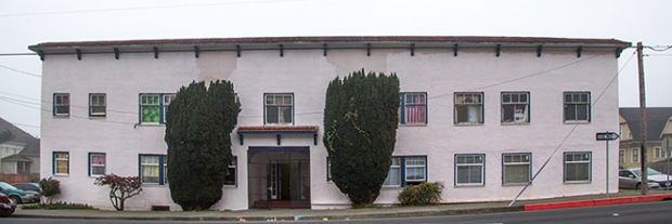 The Squireses' 833 H St. property, which has since been boarded up by the city, is up for sale. - FILE