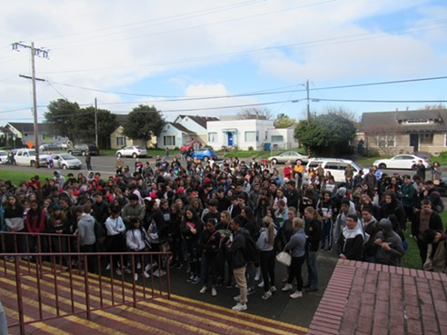 More than 100 students walked out of Eureka High School and gathered on the front steps. - LINDA STANSBERRY