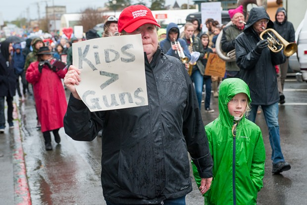 Angela Owen marches with her 7-year-old son Liam Yder. - MARK MCKENNA