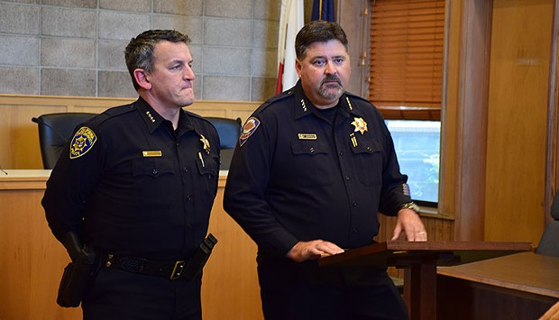 Former Arcata Police Chief Tom Chapman, right, at a press conference with University Police Chief Donn Peterson last year. - THADEUS GREENSON