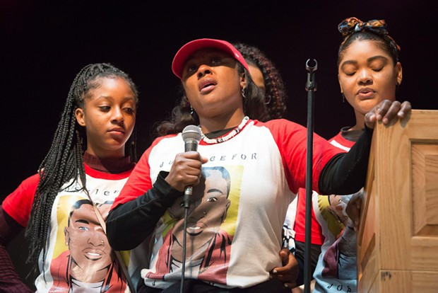Charmaine Lawson (center) stands with her family at Sunday's memorial for her son. - MARK MCKENNA