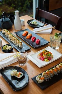 Clockwise from upper left: Klamath Roll, nigiri sushi, Tokyo Mule, butsugiri, the Kani Crunch Roll, Vegetarian Rolls, the Full Moon oyster shooter. - PHOTO BY AMY KUMLER. STYLING BY LYNN LEISHMAN.