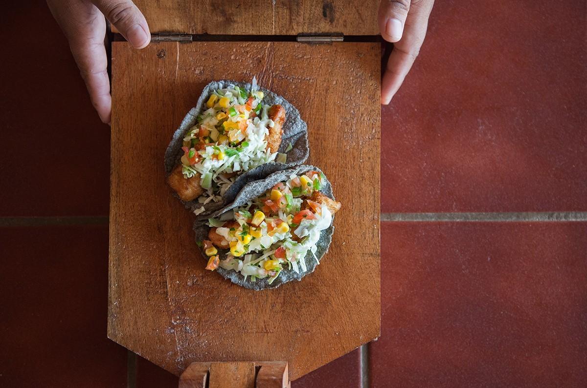 Handmade blue corn fish tacos. - AMY KUMLER