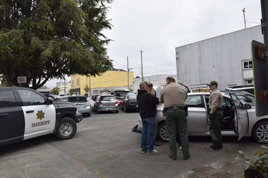 Bob Shinn speaks with deputies at the scene of the traffic stop and subsequent arrests. - THADEUS GREENSON