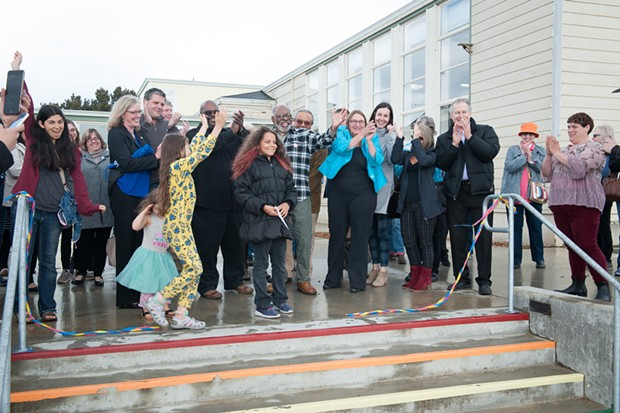 Everyone's all smiles after Salem Smith, who was in the Seed program at the center from the beginning, cut the ribbon celebrating the completion of phase one of the Jefferson Community Center and Park. - MARK MCKENNA
