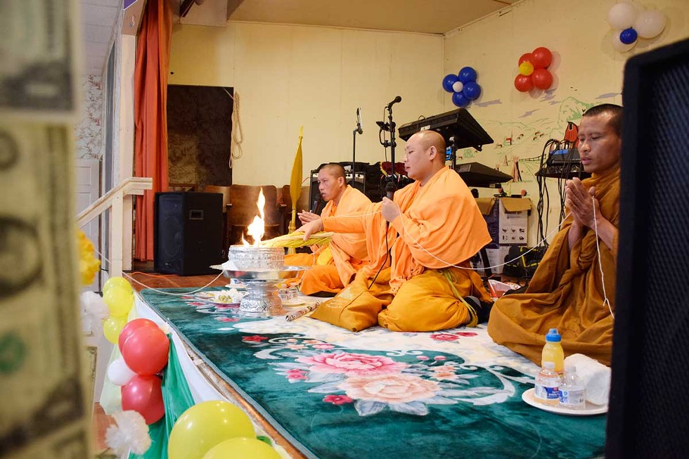 Monks from Wat Lao Saysettha, a Buddhist temple in Santa Rosa, deliver the New Year blessings and prayers. - PHOTOS BY JENNIFER FUMIKO CAHILL
