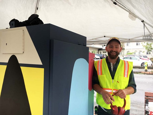 Jonathan DeSoto painting a utility box on the corner of E and Fourth streets in Eureka. - PHOTO BY JENNIFER FUMIKO CAHILL